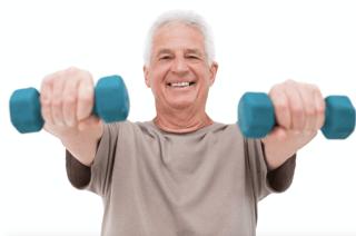 Older male holding dumbbells