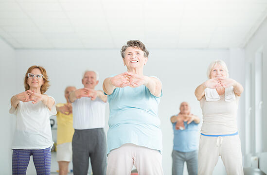 older adults taking a fitness class together
