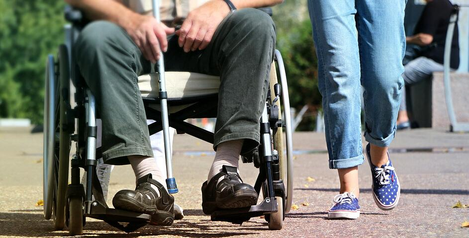 wheelchair and person walking