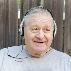 elderly man listening to headphones