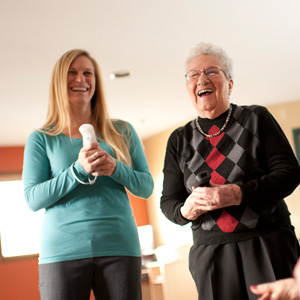 two women playing with wii controllers and laughing