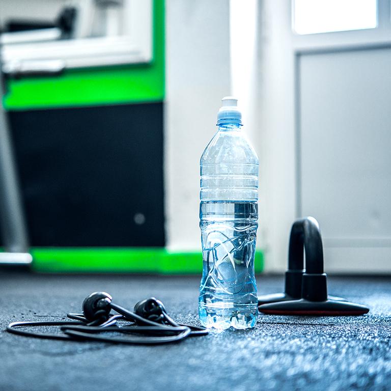 Water bottle and headphones